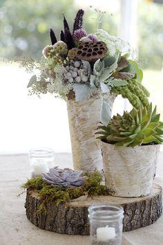 Un vase avec un tronc d'arbre
