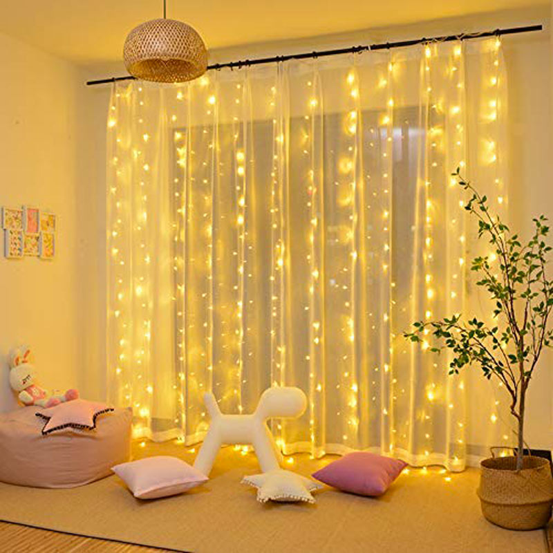 Lumières jaunes pour rideaux Noël.