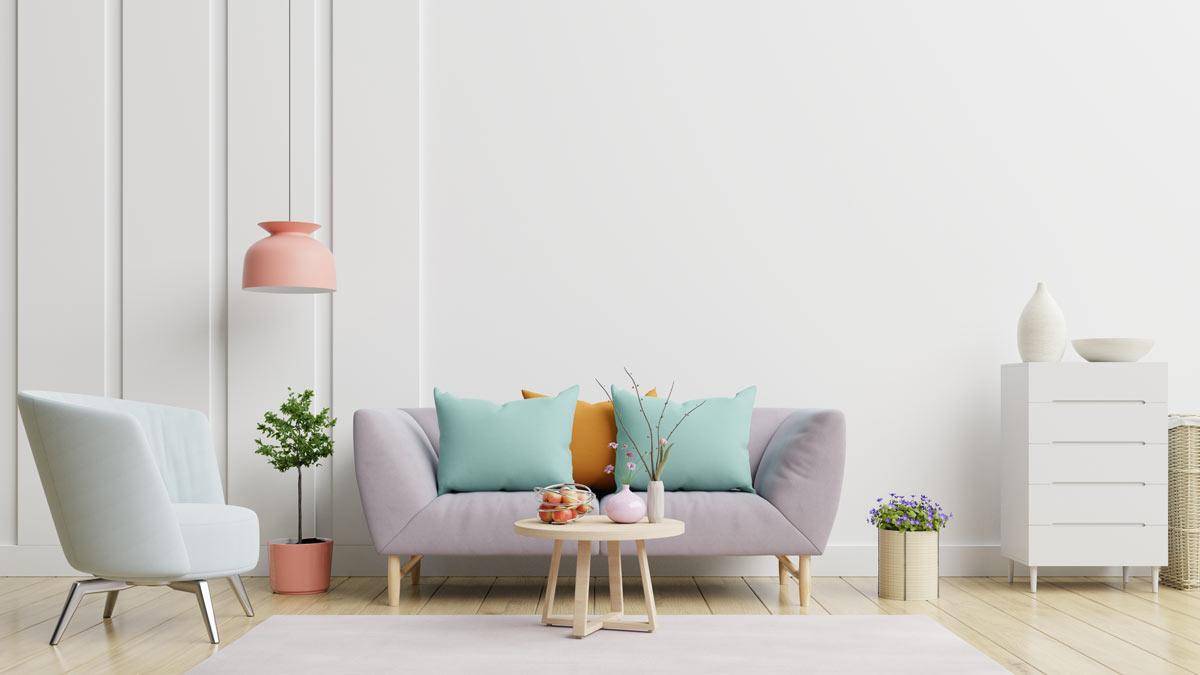 Composition canapé avec coussins couleurs pastel.