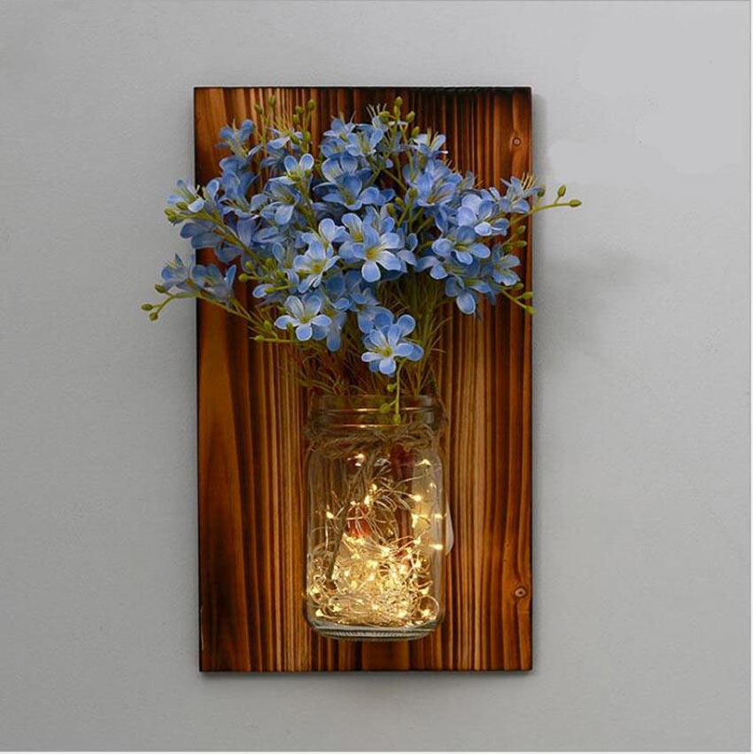 style rustique DIY fleurs bleues avec bocal sur bois foncés